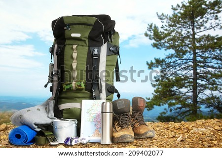 Camping elements/ equipment on top of the mountain. Royalty-Free Stock Photo #209402077