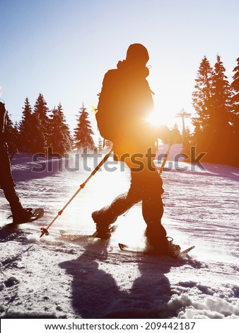 walking on the snow in the mountains #209442187