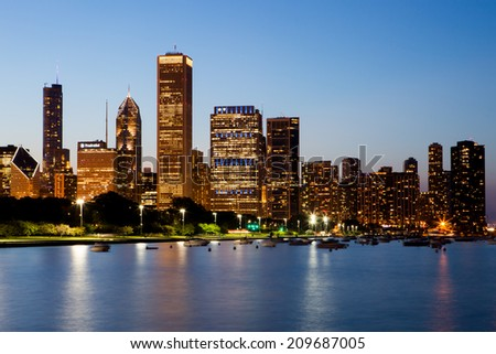 Chicago, USA - 12 July 2014: The Chicago skyline just after sunset on a hot summer's day in Illinois, USA #209687005
