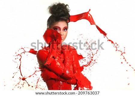 Beautiful Woman Covered in Bright Paint Splatter Royalty-Free Stock Photo #209763037