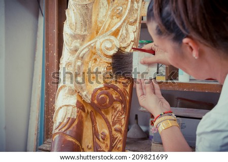 Application of Gold Leaf to an ancient picture frame