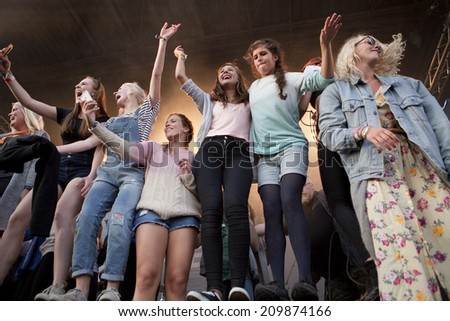 Traena, Norway - July 11 2014: during the concert of the Norwegian band Ida Maria  at the Traenafestival, music festival taking place on the small island of Traena #209874166