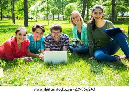 Group of students studying together in campus ground #209956243
