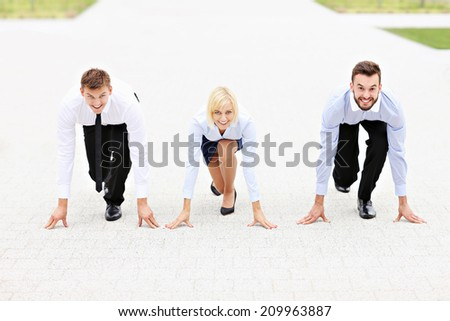 A picture of a group of business people ready to compete in a race
