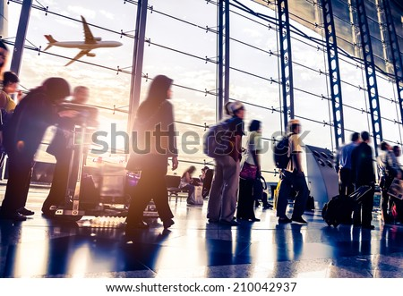 Passengers in an airport Royalty-Free Stock Photo #210042937