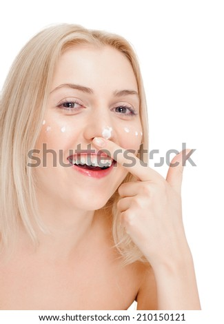 Portrait of young happy smiling cheerful beautiful blond woman applying cream. white background #210150121