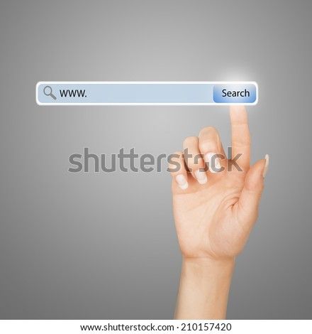 technology, searching system and internet concept - woman hand pressing Search button #210157420
