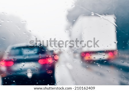 Bad Weather Driving on a Highway - Traffic Jam #210162409