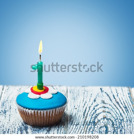 Cupcake with number one on a blue background. birthday greetings #210198208