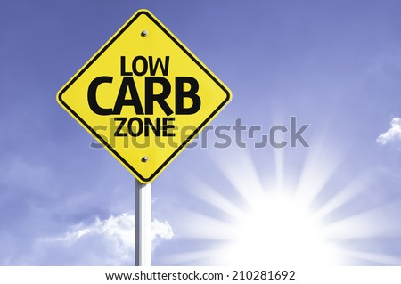 Low Carb Zone road sign with sun background  Royalty-Free Stock Photo #210281692