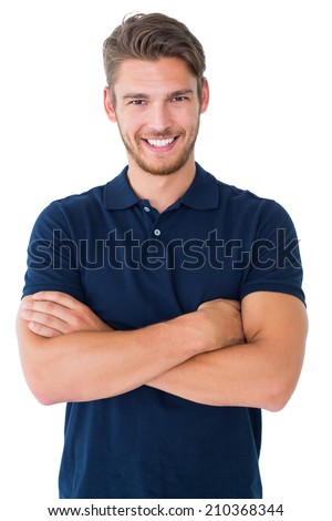 Handsome young man smiling with arms crossed on white background #210368344