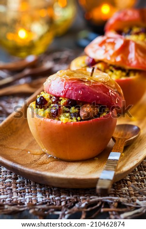 Baked apples with couscous,nuts and dried berries #210462874