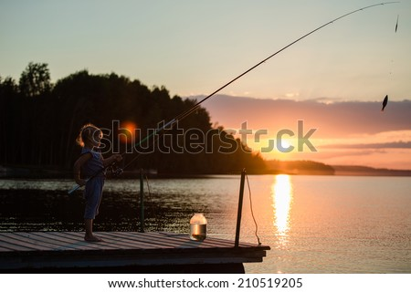 Young girl fishing under a sunset in Finland #210519205