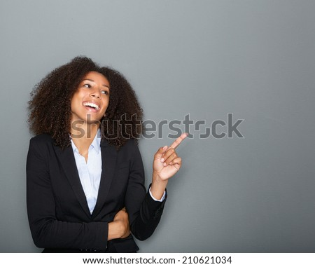 Portrait of a young african american business woman pointing finger #210621034