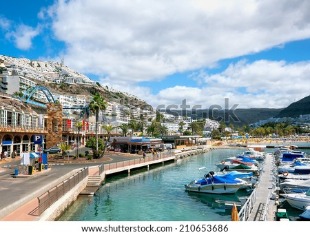 View of resort town and beach of Puerto Rico. Gran Canaria. Royalty-Free Stock Photo #210653686