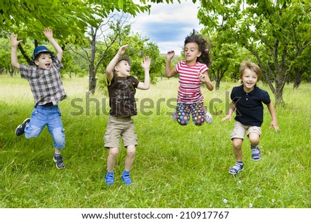 Kids Jumping in a orchard summer day #210917767