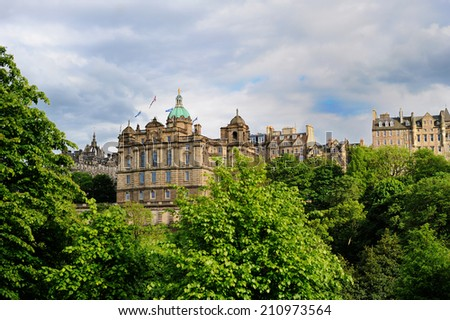 Beautiful view of the city of Edinburgh in the summer evening #210973564