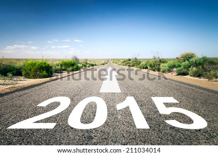 An image of a road to the horizon with text 2015 Royalty-Free Stock Photo #211034014