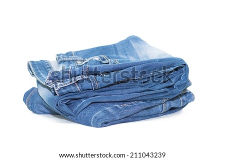 Lot of different blue jeans isolated on white #211043239