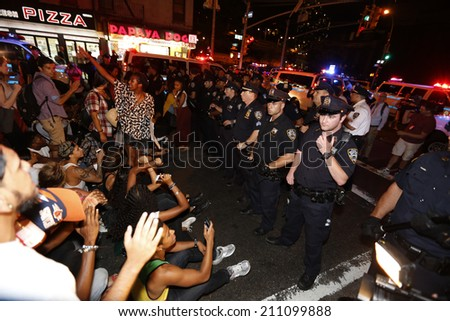 NEW YORK CITY - AUGUST 14 2014: Thousands of New Yorkers responded to Anonymous's call for a Day of Rage march & rally to demand justice for the police-related deaths of Michael Brown & Eric Garner #211099888