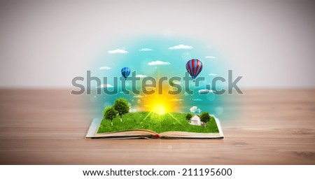 Open book with green nature world coming out of its pages, ecological concept #211195600