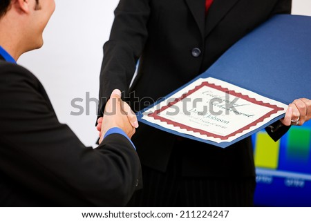 Office: Employee Gets A Certificate Of Achievement #211224247
