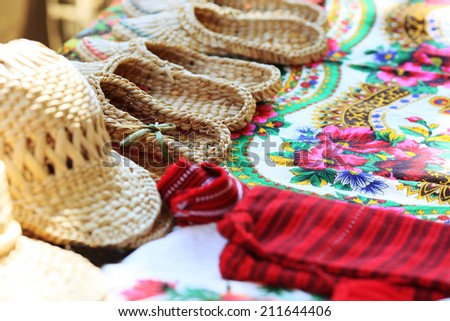 Ukrainian traditional clothes with sandals made of bark #211644406