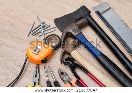 set of different tools for work on wood background #211697047