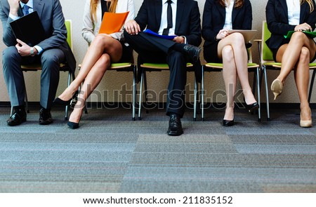Photo of candidates waiting for a job interview Royalty-Free Stock Photo #211835152