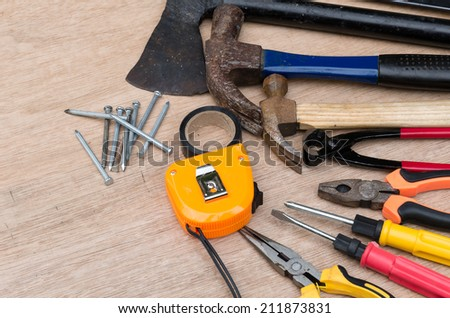 set of different tools for work on wood background #211873831