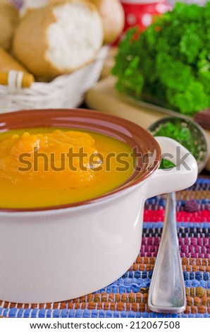 Bright orange soup color, poured in portions of the plate #212067508