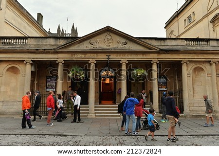 BATH - AUG 9: Unidentified tourists and locals walk past the historic Roman Baths on Aug 9, 2014 in Bath, UK. The roman era baths are a major attraction receiving over one million visitors a year. #212372824