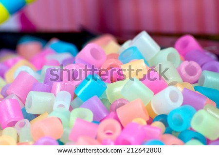 close Up of pixel beads, plastic granules or plastic beads