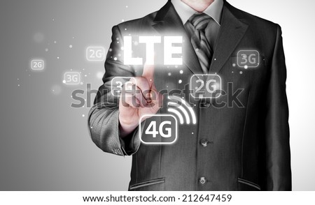 businessman is pushing his finger on lte button Royalty-Free Stock Photo #212647459