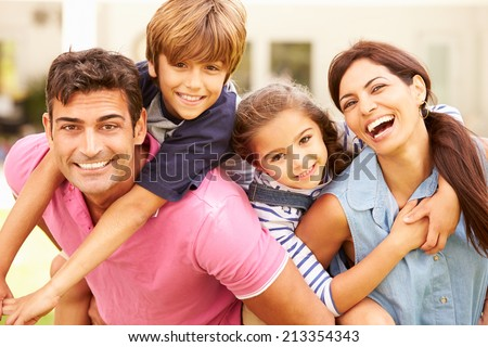 Portrait Of Happy Family In Garden At Home #213354343