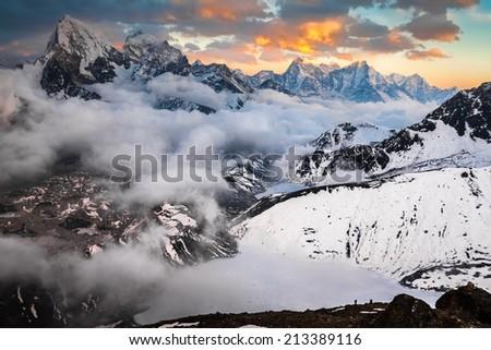 View from Gokyo Ri to Gokio, lake Dudh Pokhari, glacier Ngozumba, tops Cholatse and Tabuche #213389116