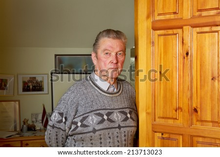 Old man in a home. #213713023