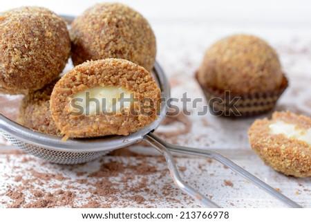 Sweet homemade pralines stuffed with honey and vanilla cream,selective focus  #213766978