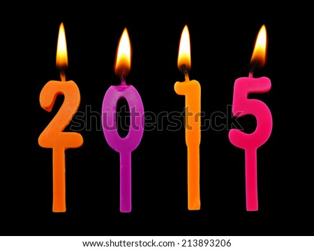 Burning candles on black background, number 2015, new year concept