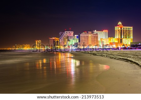 The skyline and Atlantic Ocean at night in Atlantic City, New Jersey. Royalty-Free Stock Photo #213973513