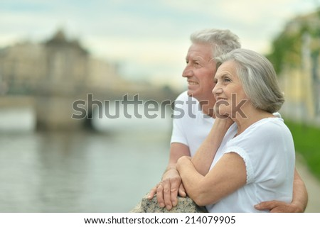 Amusing elderly couple having rest near river #214079905