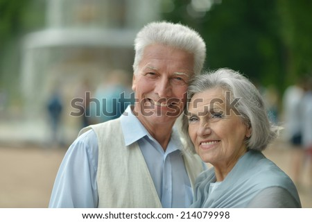 Portrait of cute happy senior couple outdoors #214079998