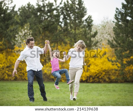 Young couple swinging daughter between them #214139638