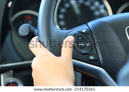Business woman push a button in modern car. #214170361