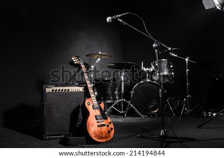 Set of musical instruments during concert Royalty-Free Stock Photo #214194844