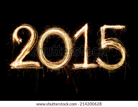 2015 word written with Sparkle firework on black background Royalty-Free Stock Photo #214200628