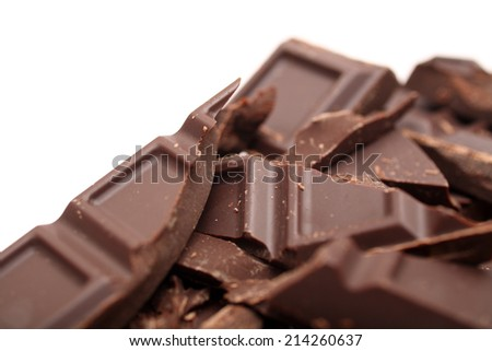 Pieces of chocolate on white background. Closeup. #214260637