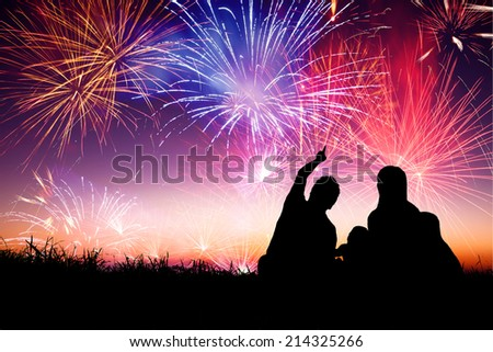 happy family sitting on floor and watching the fireworks #214325266