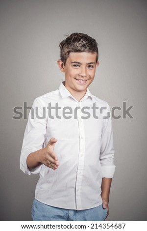Handsome young smiling man giving extending arm for handshake at camera gesture isolated grey wall background. Positive human emotions, facial expressions, feelings, body language #214354687