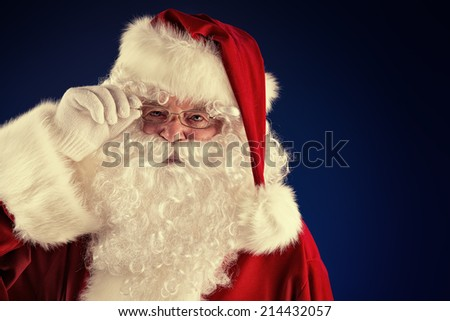 Portrait of a traditional Santa Claus. Over dark background. Christmas. #214432057